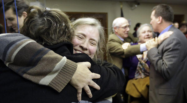C. Kelly Smith, right, a member of Marriage Equality Rhode Island, hugs fellow member Wendy Becker after a house committee vote on gay marriage.