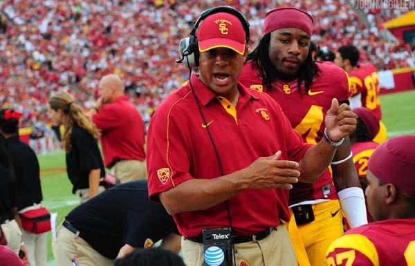 Marvin Sanders talks strategy with USC players during a game.
