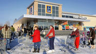 As soon as the ribbon dropped Thursday morning, shoppers began cramming the aisles of the new ALDI's Food Market off Edwin Miller Boulevard. For many of them it was their first look at a different grocery shopping experience.