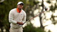Tiger Woods struggled at the finish of the first round Thursday at the Farmers Insurance Open, finishing with two bogeys and scrambling for par on No. 18 in the final hour of play at Torrey Pines.