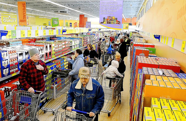 People shop in the new ALDI's grocery store Thursday in Martinsburg, W.Va.