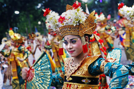 Balinese dancers take part in a cultural parade during a New Year's celebration.