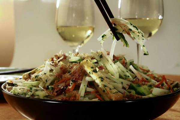A green papaya salad would pair well with a sweeter white blend with a crisp minerality.