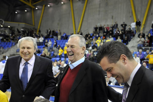 CCSU coach Howie Dickman, former UConn coach Jim Calhoun and Quinnipiac coach Tom Moore share a laugh at center court before the start of Thursday's game between Quinnipiac and Central in Hamden. Calhoun was honored for his contributions to Connecticut basketball.