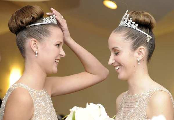 Princess Stephanie Beck, left, shares a moment with the newly crowned Courtney Perry.