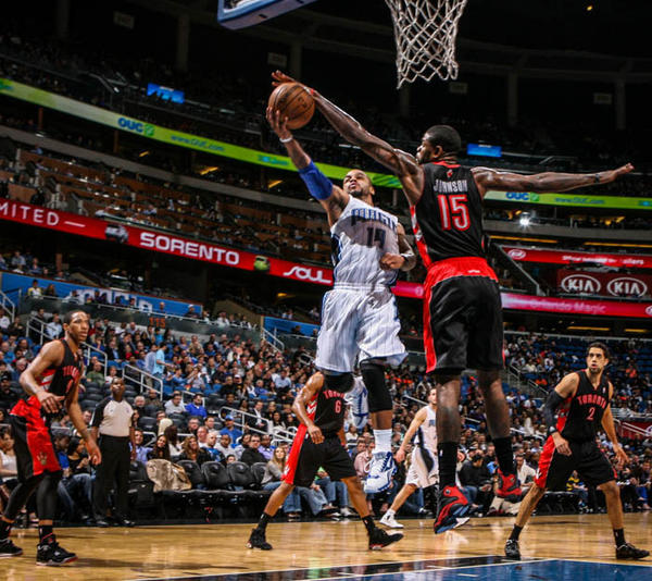 Magic guard Jameer Nelson (14) is blocked by Toronto's Amir Johnson (15) as he goes up for a layup during second quarter action of a game against the Toronto Raptors at Amway Center in Orlando, Fla. on Thursday January 24, 2013.