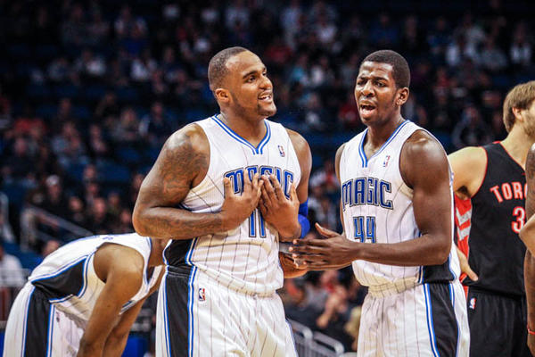 Orlando Magic Andrew Nicholson (44) tries to calm forward Glen Davis (11), who received a technical foul for a confrontation with Toronto Raptors' Aaron Gray (34), at Amway Center in Orlando, Florida, Thursday, January 24, 2013.
