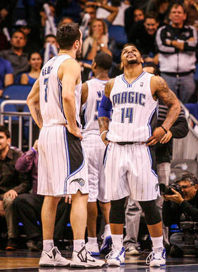 Magic guards J.J. Redick (7) and Jameer Nelson (14) react after Toronto's DeMar DeRozan (10) hit a fadeaway jump shot in the final seconds to clench a 97-95 win for the Raptors at Amway Center in Orlando, Fla. on Thursday January 24, 2013.