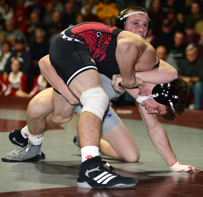Bottom Face) Easton's Kyler Kilpatrick is defeated by Phillipsburg's Andrew Kaluzny with a score of 8-5 in the 145 pound weight class in their wrestling match held at Phillipsburg High School on Thursday.
