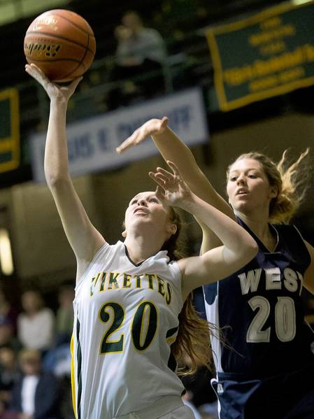 Central Catholic's Emma Redding shoots against Pocono Mountain West's Kaitlin Yokum in their girls basketball game at Central Catholic in Allentown on Tuesday December 11, 2012.