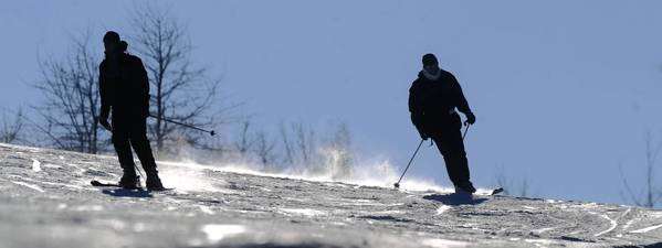 Skiers navigate down the Vista Trail at Blue Mountain Ski Area Tuesday afternoon December 21, 2010.