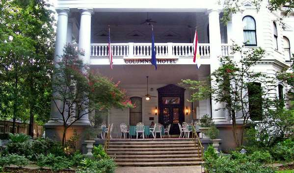 The Columns Hotel in New Orleans' Garden District is popular for evening cocktails on the veranda.