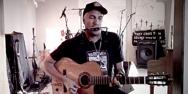 "Tom Morello performing in the movie ""Let Fury Have the Hour."""