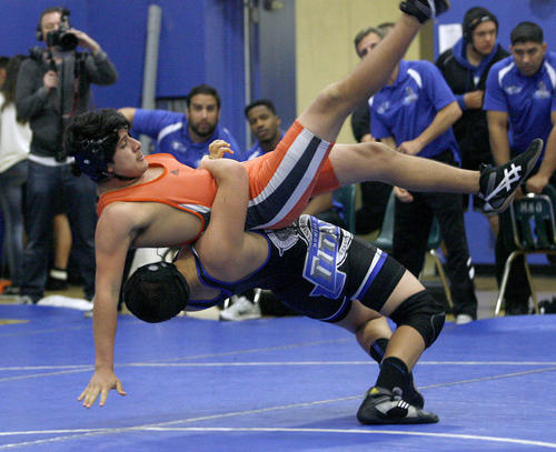 San Marino High's Michael Scott, throwing his opponent, won the 170 lb. match vs. South Pasadena High's J.C. Limon during match at San Marino High School in San Marino on Thursday, January 23, 2013.