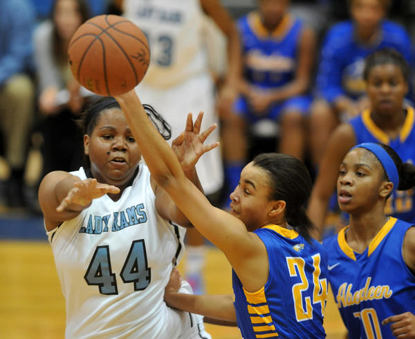 Aberdeen #24 Stephanie Jones, center, keeps the ball away from Digital Harbor #44 Infiniti Alston, as Aberdeen teammate  #10 Endia Jones moves in. Aberdeen H.S. held the lead throughout the game against Digital Harbor in the girls' Basketball Academy, played at Morgan State.