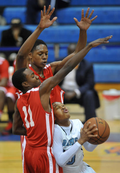 Digital Harbor #10 Donte Lloyd tries to shoot against the blocks by Woodlawn #11 (? not on roster) and #52 Malcolm Smith (in back). Digital Harbor beat Woodlawn H.S, 55-45, in the boys' Basketball Academy, played at Morgan State.