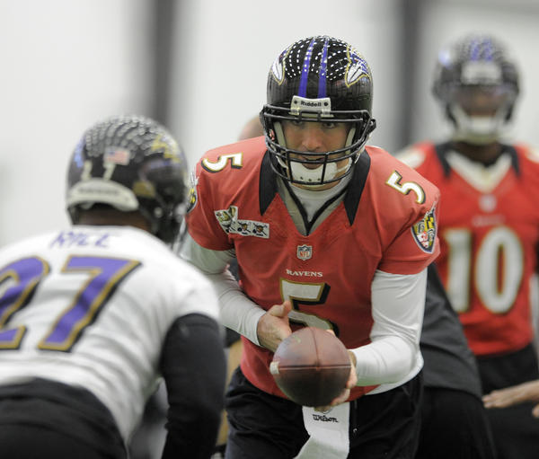 Ravens' quarterback #5 Joe Flacco hands off to Ray Rice during practice. Baltimore Ravens  hold press conferences and practice at the Castle today as they get ready to face the San Francisco 49ers in the Super Bowl.