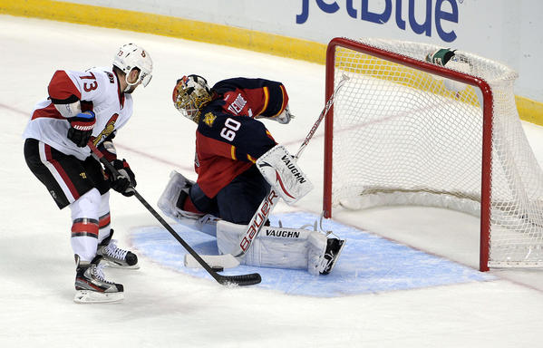 Florida Panthers goalie Jose Theodore denies Ottawa Senators Guillaume Latendresse from scoring a goal during the third period.