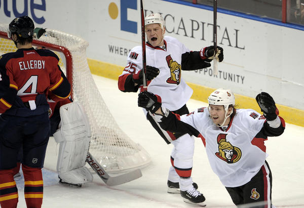 Ottawa Senators Chris Niel, left, and Zack Smith celebrate a first period goal against the Florida Panthers.
