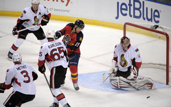 Florida Panthers Scottie Upshall tries to slip the puck past Ottawa Senators goalie Craig Anderson during the second period.