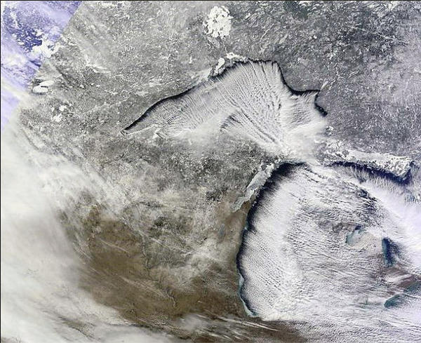 This satellite image shows how clouds are whipped into bands by shearing winds cutting through sinking and rising air ¿ all necessary components of lake effect snow, according to Nick Schwartz, meteorologist for the National Weather Service in Gaylord.