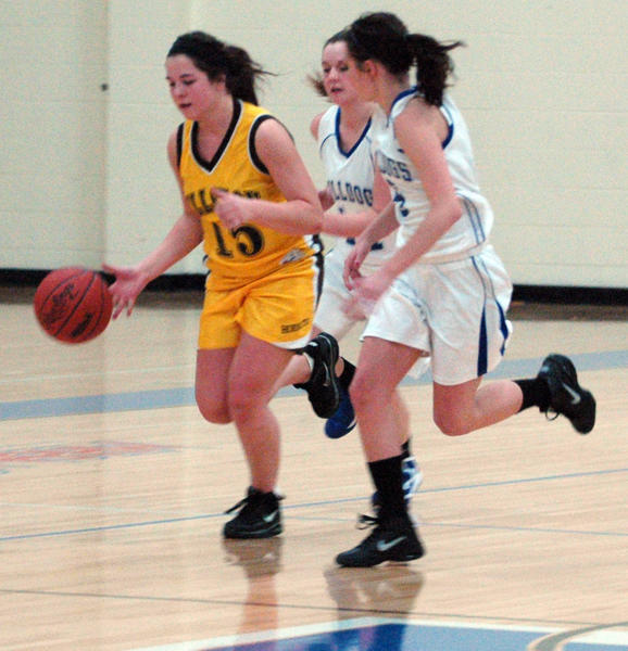 Pellston junior guard Abbie Welch (left) brings the ball upcourt against Inland Lakes during Thursday's Ski Valley Conference contest at the Inland Lakes High School gym. The Hornets defeated the Bulldogs, 39-32.