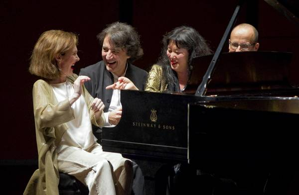 Anne-Marie McDermott (left to right), Jean-Efflam Bavouzet, Wu Han and Andre-Michel Schub play the encore together during a performance the ensemble of pianists from the Chamber Music Society of Lincoln Center at Harris Theater last year.