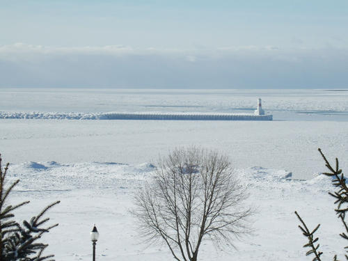 Ice is seen covering a significant part of the water surface around Petoskey's harbor Thursday, as viewed from Sunset Park. While open patches remain in some spots of Little Traverse Bay, ice cover has become more extensive during this week's cold snap.