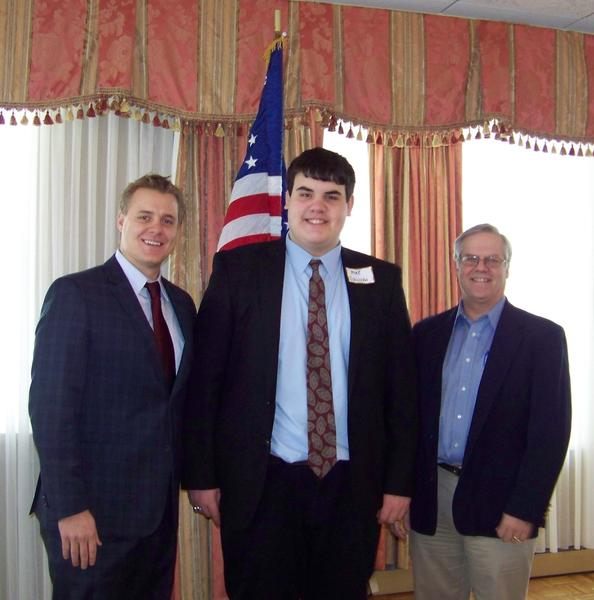 Michael Sullivan of Petoskey Boy Scout Troop 5 is presented a State of Michigan Special Tribute by (right) Sen. Howard Walker and Rep. Frank Foster (left) at Monday's Emmet County Republican Women meeting at Stafford's Bay View Inn.