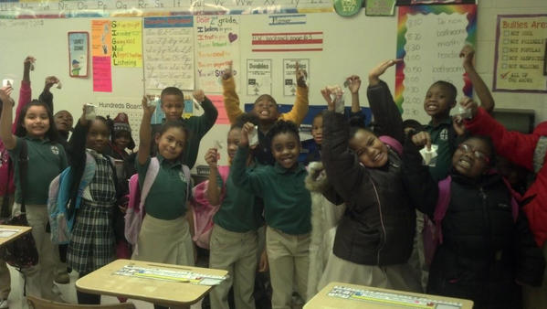 Second-graders in Memphis, Tenn., hold their prized Petoskey stones, gifts from Judy Knowles of Petoskey.