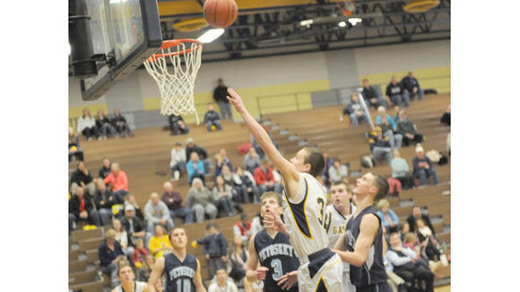 Gaylord's Zach Pasternak goes up strong during the Blue Devils' 55-51 loss to Petoskey Tuesday.
