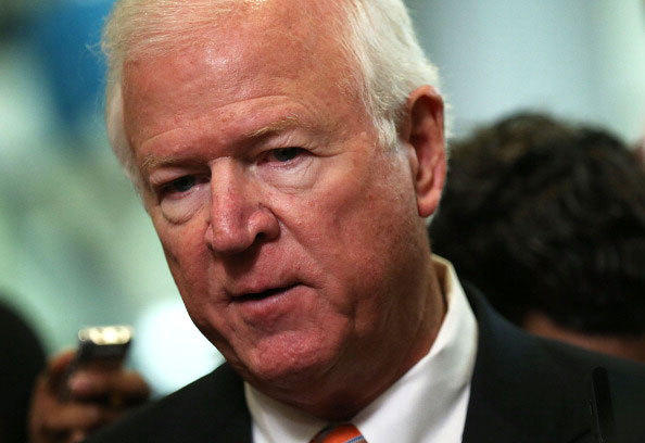 U.S. Select Committee on Intelligence ranking member Sen. Saxby Chambliss (R-GA) speaks to members of the media after a hearing on the Benghazi attack November 16, 2012 on Capitol Hill in Washington, DC. Former Central Intelligence Agency (CIA) Director David Petraeus testified before the committee about the September 11 attacks on the American diplomatic compound in Benghazi, Libya, that killed Ambassador Christopher Stevens and three other Americans.