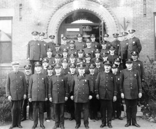 The Evanston Police Department, as seen in this 1921 photo. Someone used a pencil to draw an arrow pointing at an officer in the back, but it is not clear why.
