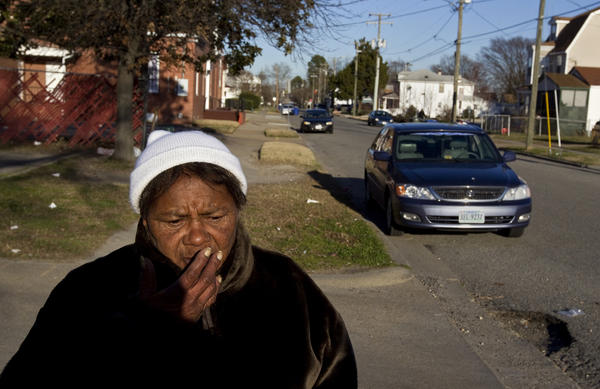 "Teresa Miller, 54, reflects on the community she's found on the street corners in the southeast Newport News community. Miller, who was an alcoholic 33 years ago, says she values the conversation and company at intersections like 32nd Street and Jefferson Avenue. She says she appreciates a new effort by Newport News Police to stop by the street corners and provide resources for substance abuse treatment and job placement. ""I've seen a lot of people that used to hang on this corner perish just from boredom, loneliness, alcoholism, drug abuse, and it's like, where did everybody go?"""