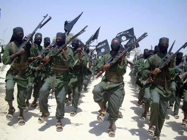 In this Feb. 17, 2011, photo, Shabab fighters march with their weapons during military exercises on the outskirts of Mogadishu, Somalia.