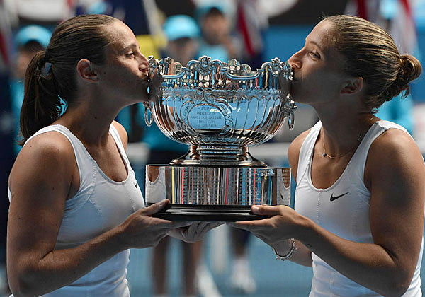 Italy's Roberta Vinci, left, and Sara Errani taste sweet victory as winners of the women's doubles final at the Australian Open in Melbourne, Australia on Jan. 25.