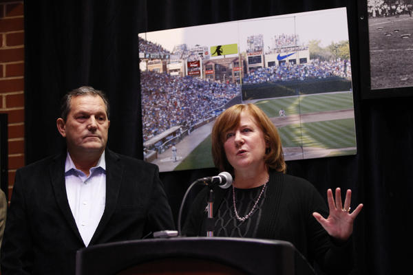 George Loukas, left, owner of the Cubby Bear and various Wrigleyville apartment buildings, and Beth Murphy, of Murphy's Bleachers and the Wrigleyville Rooftops Association, speak at a news conference at Murphy's about the association's proposal to erect LED billboards on rooftops and share revenue with the Chicago Cubs.