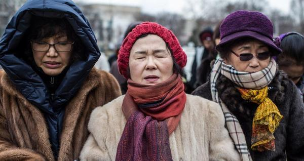 Abortion opponents Grace Jang, Sharon Lee and Virginia Kim, all from Springfield, Va., pray before an anti-abortion march Friday in Washington.