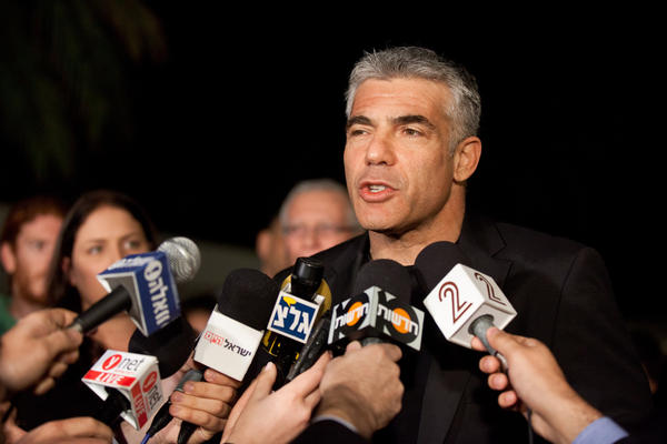 Yair Lapid, leader of the Yesh Atid party, won votes from moderate Likud members who hoped he would soften Benjamin Netanyahu's policies.