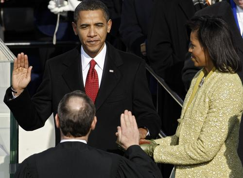 President Obama swears in during the 2009 inaugural ceremonies.