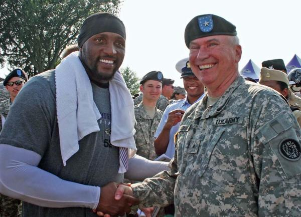 """I would have to say that while I had the opportunity to break a huddle with Ray (Lewis) and the team during training camp, my greatest memory has been visiting troops in Iraq and Afghanistan where team support and spirit was very evident even in harsh conditions. The Ravens have always been great supporters of the Maryland Guard and to see the troops follow the Ravens even while in combat is very special. Ray Lewis is called the ""General"" for his leadership on and off the field. I became the Adjutant General in 2008 and had the opportunity to meet players at training camp. I remember a young player coming up to me when I was in uniform and asking if he could get his picture taken with me. I remembered his number and later looked him up on the roster, it was Ray Rice."""