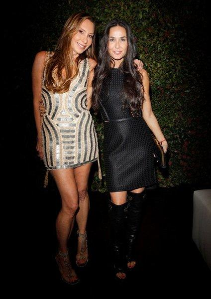 Jacqui Getty, left, and Demi Moore wear head-to-toe Ferragamo at an event hosted by Harper's Bazaar to celebrate the label's spring-summer 2013 collection.