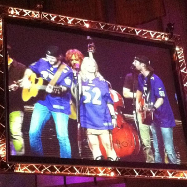From left to right: Thomas Rhett (in Ray Rice jersey), Miranda Lambert (in Ray Lewis jersey) and Dierks Bentley (in Joe Flacco jersey).