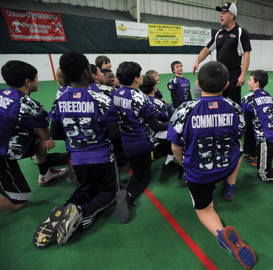"Hampstead Ravens' coach Scott Melville, talks to the team. In 1996 the Hampstead Ravens were formed and received permission to use the baltimore Ravens logos and uniform style, plus the""shield"" using a ""H"" substituted for the ""B"" the Ravens' shield has standing for Baltimore."