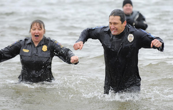 Police officer Barbara Natoli of the Montgomery County Police and Cpl. Chris Peck of their Rockville City Police during their plunge.