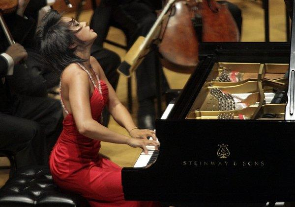 Pianist Yuja Wang, shown last year at Walt Disney Concert Hall, will perform in Orange County for the 2013-14 season of the Philharmonic Society.