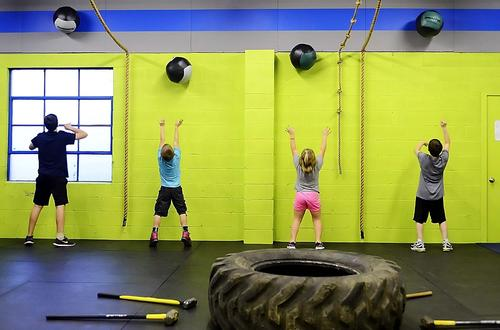 Children do the wall ball exercise at CrossFit 25404 in Martinsburg, W.Va.