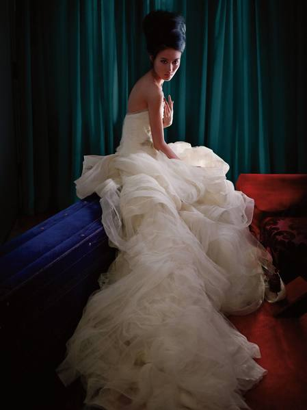 Cascading tiers, strapless, corseted bridal gown