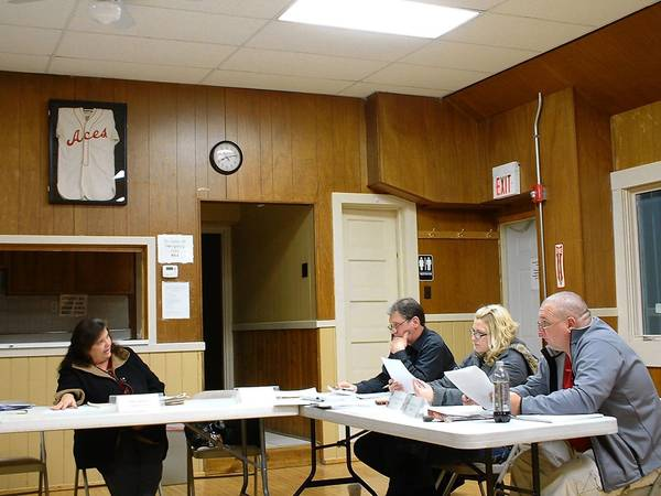 Homer Township Supervisor Pam Meyers (far left) and Trustees Ed Kalas, Christina Neitzke and John Kruczek discuss upcoming programs at the Jan. 14 meeting.