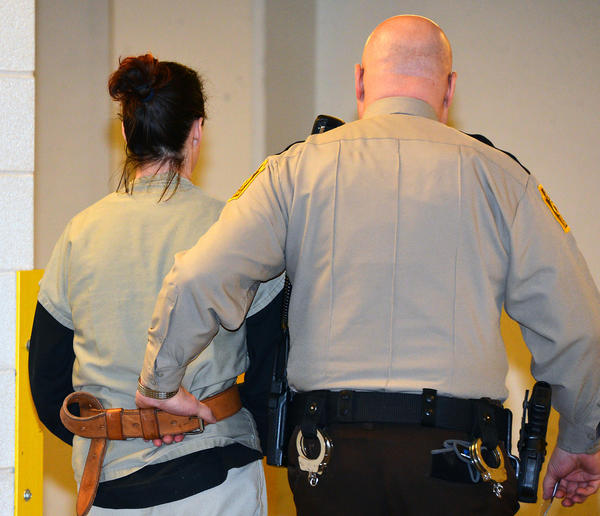 "Ashley Eskaff is escorted from sentencing at Lehigh County Court on Friday afternoon. She is part of the quartet of ""thrill"" robbers. The others, Ashley Horning, Luis Enrique Ortiz, and Isaiah Baker, have already plead guilty to the crimes and face similar charges in Northampton County."